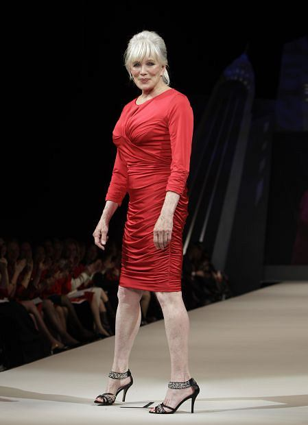 Actress Linda Evans models Tadashi Shoji during the Heart Truth Red Dress fashion show in New York, Wednesday, Feb. 8, 2012.  (AP Photo/Kathy Willens)