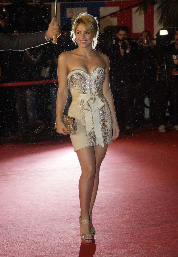 Colombian performer Shakira arrives for the NRJ Music awards ceremony, in Cannes, southeastern France, Saturday, Jan. 28, 2012. (AP Photo/Lionel Cironneau)