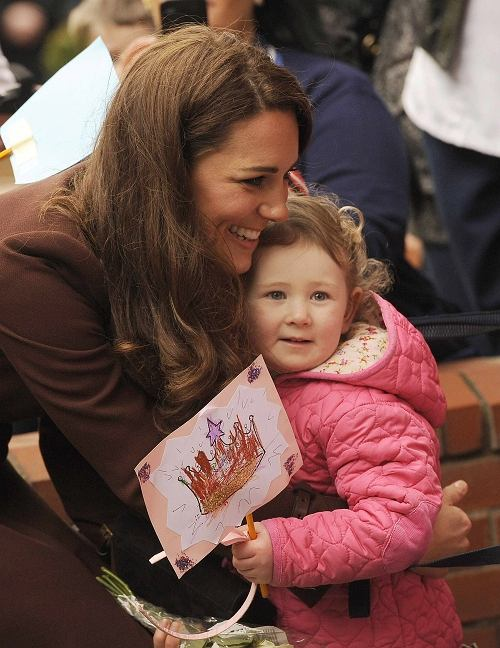 Britain's Catherine, Duchess of Cambridge embraces a child during a vist to Alder Hey Hospital in Liverpool, northern England February 14, 2012.       REUTERS/Nigel Roddis (BRITAIN - Tags: ENTERTAINMENT SOCIETY ROYALS)