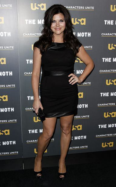 "Actress Tiffani Thiessen arrives at USA Network and The Moth's ""A More Perfect Union: Stories of Prejudice and Power"" Characters Unite storytelling event in West Hollywood, Calif., Wednesday, Feb. 15, 2012.  The event features storytellers sharing the personal experiences with discrimination and bigotry. (AP Photo/Matt Sayles)"
