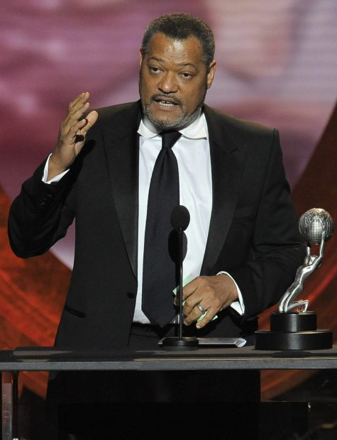 """Laurence Fishburne accepts the award for outstanding actor in a television movie, mini-series or dramatic special  for """"Thurgood"""" at the 43rd NAACP Image Awards on Friday, Feb. 17, 2012, in Los Angeles. (AP Photo/Chris Pizzello)"""