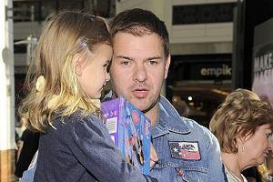 Tomasz Karolak z córką.