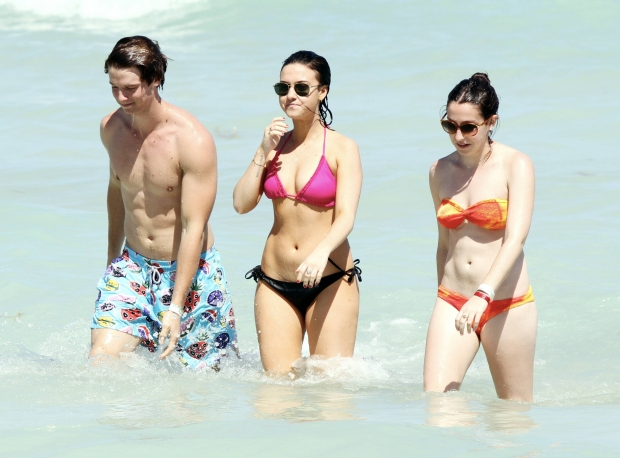 "MAVRIXONLINE.COM - Former California governor Arnold Schwarzenegger's son, Patrick Schwarzenegger was spotted showing off his beach tone body while spending time in sun with friends in Miami Beach. The 18 year old model was seen frolicking in the ocean surrounded by a couple of bikini clad ladies as well as hanging out with his guy friends. It was recently reported that Patrick was involved in a ski accident in Sun Valley which left him with a deep cut above his butt cheek. He wasn't seriously injured and tweeted a photo stating ""Little ski accident today. Some bruises and stitches down back and but [sic]. Thanks to sun valley doctors for everything."" Miami Beach, FL. 24th March 2012.  Byline, credit, TV usage, web usage or linkback must read MAVRIXONLINE.COM.  Failure to byline correctly will incur double the agreed fee.  Tel: +1 305 542 9275."