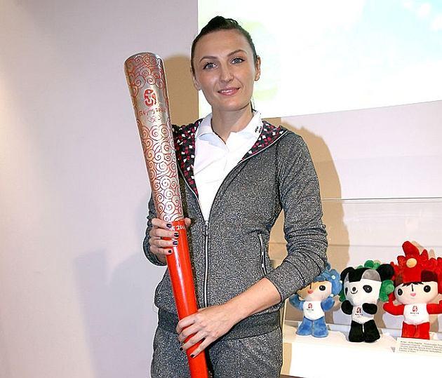 Reni Jusis - zdjęcie ze zniczem olimpijskim