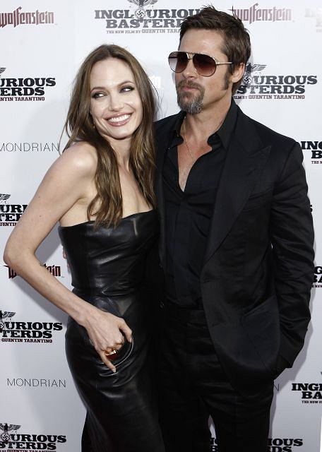 Cast member Brad Pitt, right, and Angelina Jolie arrive at the premiere of