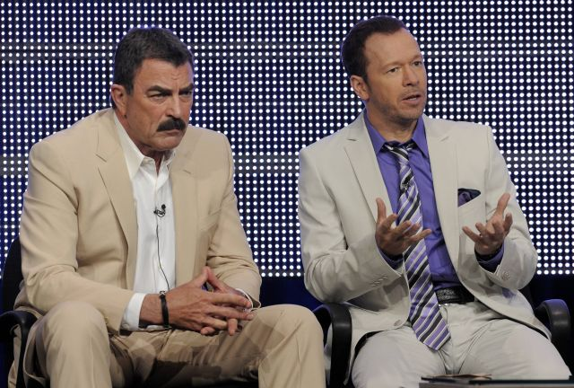 "Tom Selleck, left, and Donnie Wahlberg, cast members in the television show ""Blue Bloods,"" take part in a panel discussion on the show at the CBS, Showtime and The CW Television Critics Association summer press tour in Beverly Hills, Calif., Wednesday, July 28, 2010. (AP Photo/Chris Pizzello)"