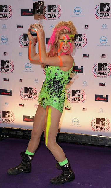 Ke$ha poses with her award for Best New Act in the winners area at the MTV European Music Awards 2010, in Madrid, Sunday, Nov. 7, 2010.(AP Photo/Dave Fisher)