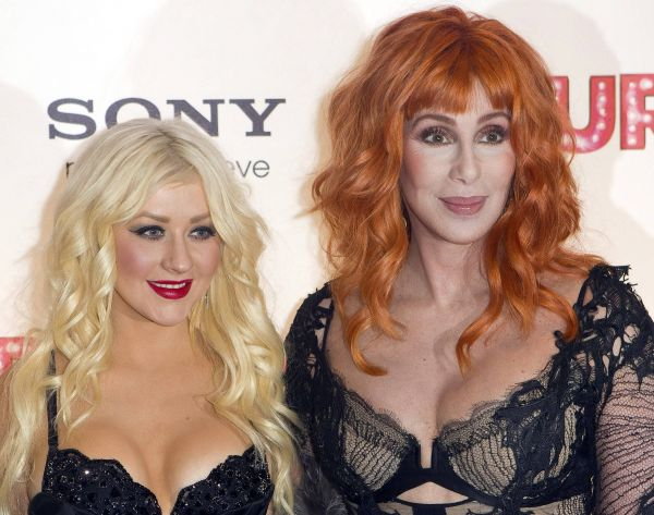 U.S actress and singers Cher, right, and Christina Aguilera, arrive for the UK Gala Premiere of Burlesque, Monday, Dec. 13, 2010, at Leicester Square, in London. (AP Photo/Joel Ryan)