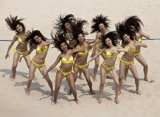Cheerleaders perform during a break in a qualifying match for the Swatch World Tour Beach Volleyball competitions in Beijing, China Friday, June 10, 2011. (AP Photo/Andy Wong)