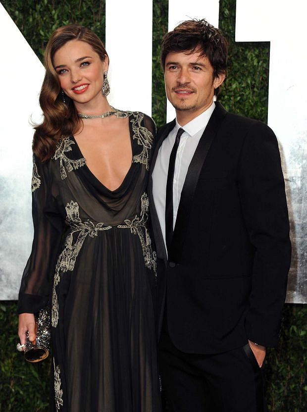 Model Miranda Kerr, left, and actor Orlando Bloom arrive at the 2013 Vanity Fair Oscars Viewing and After Party on Sunday, Feb. 24 2013 at the Sunset Plaza Hotel in West Hollywood, Calif. (Photo by Jordan Strauss/Invision/AP)