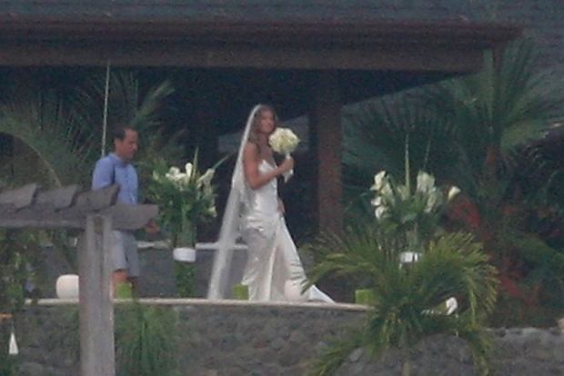 Gisele Bundchen marries Tom Brady in Costa Rica. It was the second wedding for the couple, this time with close friends and family at the models hill top home over looking the beach in Costa Rica.? Brady (in white pants)  Ref: SPL91783  040409   Picture by: SDFL / Splash News Pictured: Gisele Bundchen marries Tom Brady
