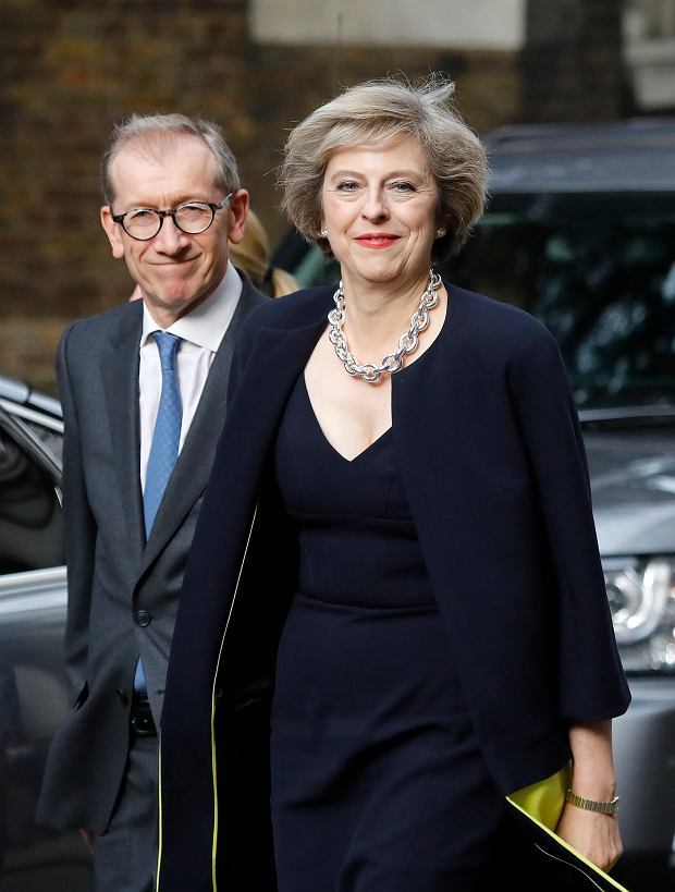 New British Prime Minister Theresa May and her husband Philip arrive at her official residence,10 Downing Street in London, Wednesday July 13, 2016. David Cameron stepped down Wednesday after six years as prime minister. (AP Photo/Frank Augstein)