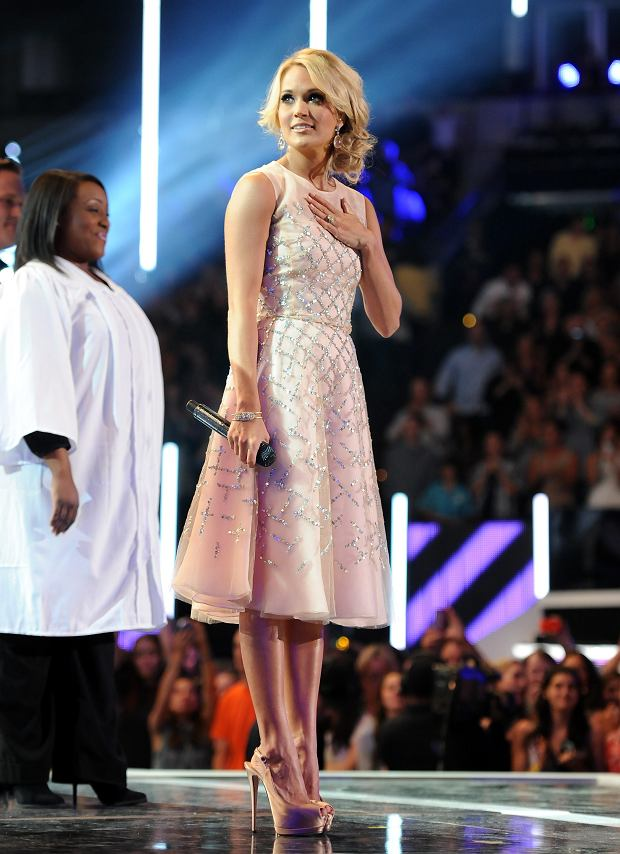 Carrie Underwood stands on stage at the 2013 CMT Music Awards at Bridgestone Arena on Wednesday, June 5, 2013, in Nashville, Tenn. (Photo by Frank Micelotta/Invision/AP)