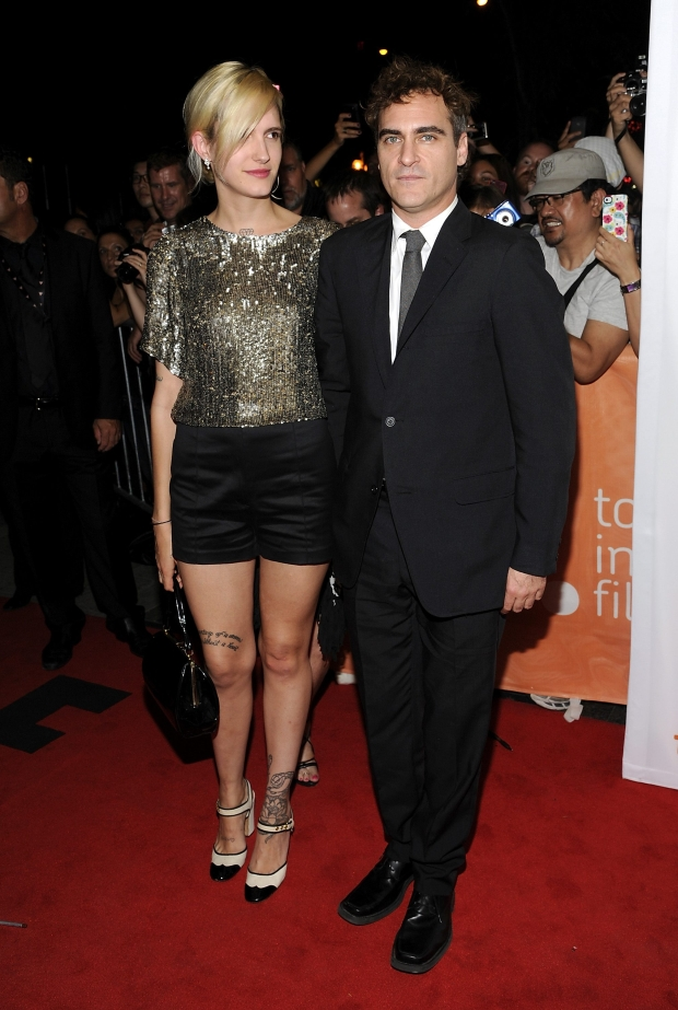 """Actor Joaquin Phoenix and his unidentified date arrive at the premiere of """"The Master"""" during the Toronto International Film Festival on Friday Sept. 7, 2012 in Toronto. (Photo by Evan Agostini/Invision/AP)"""