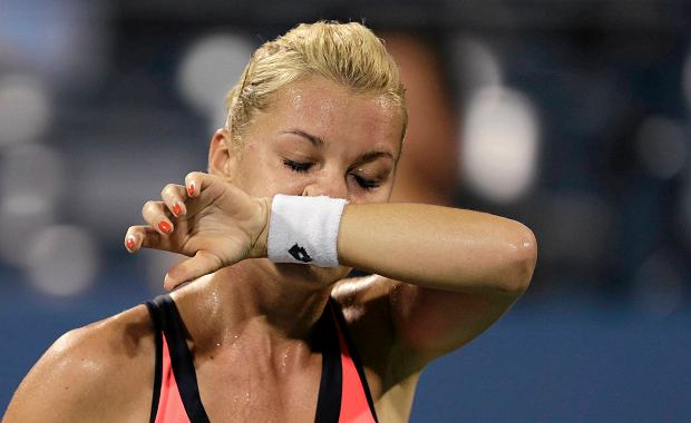 Agnieszka Radwanska, of Poland, wipes her face during the fourth round match against Ekaterina Makarova, of Russia, in the 2013 U.S. Open tennis tournament, Sunday, Sept. 1, 2013, in New York.  Makarova defeated Radwanska. (AP Photo/Charles Krupa)