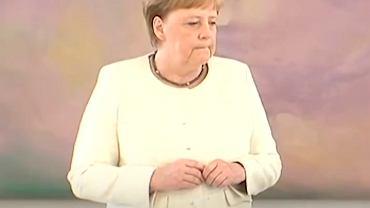 Angela Merkle ponownie dostała drgawek. Nie mogła opanować drżenia rąk. Wszystko nagrała kamera