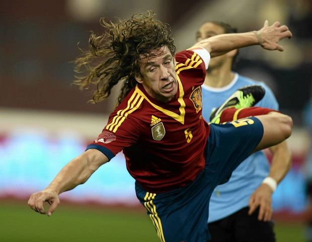 Spain's Carlos Puyol,  during the friendly soccer match against Uruguay, at the Khalifa International stadium in Doha, Wednesday, Feb. 6, 2013. (AP Photo/Osama Faisal)