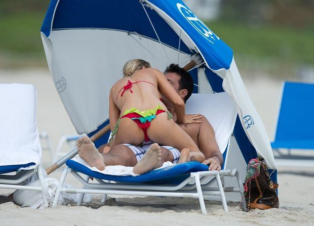 EXCLUSIVE: It appears stunning Joanna Krupa and her hunky fiance's sizzling hot romance is well and truly back on. Frolicking on Miami Beach, the the Polish-born supermodel and her club owner beau Romain Zago put on a scorching display of affection. Krupa, 33, flaunted her enviable figure in a tiny multi-colored bikini during the ocean dip. She was seen playfully leaping into his arms clad in the flirty Beach Bunny two-piece, while showering him with kisses. It seems the high-profile couple have rekindled their engagement following a three week split.   Pictured: Joanna Krupa and Romain Zago