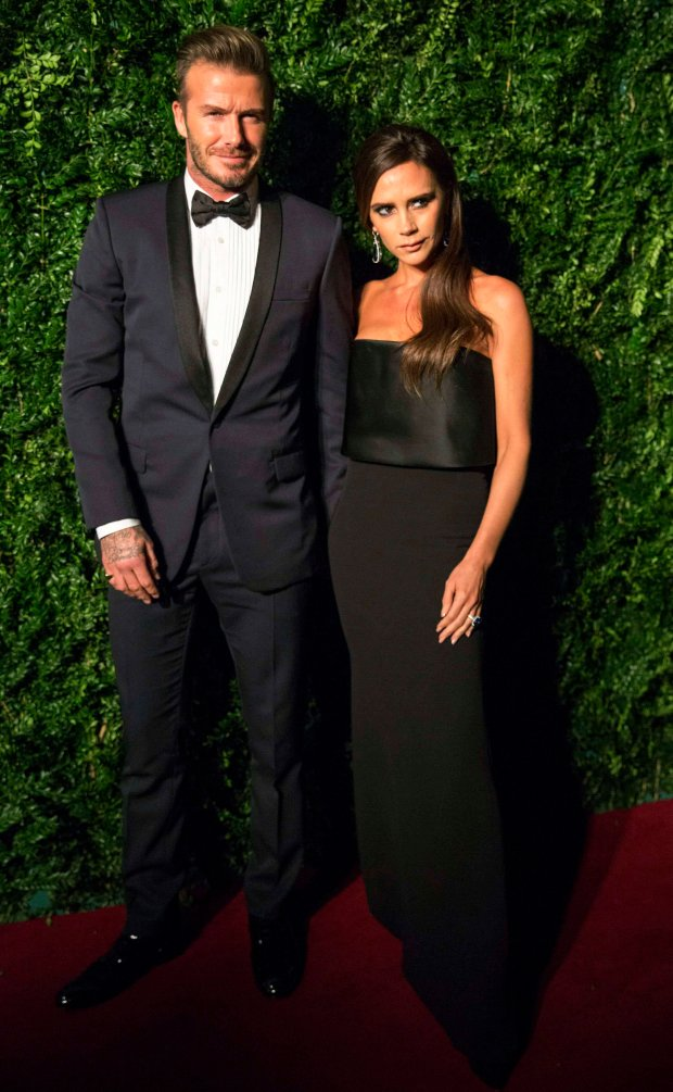 Former British soccer player David Beckham and his wife, fashion designer Victoria Beckham attend the Evening Standard Theatre Awards in London November 30, 2014. REUTERS/Neil Hall (BRITAIN - Tags: ENTERTAINMENT SPORT SOCCER)