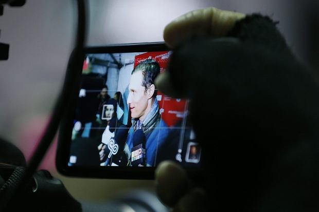 """Cast member Matthew McConaughey is photographed with a mobile phone as he is interviewed at the premiere of """"Mud"""" during the 2013 Sundance Film Festival on Saturday, Jan. 19, 2013 in Park City, Utah. (Photo by Danny Moloshok/Invision/AP)"""