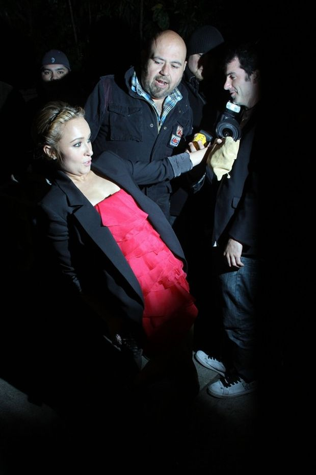 51570, WEST HOLLYWOOD, CALIFORNIA - Wednesday February 23 2011. Woah! Hayden Panettiere almost takes a tumble as she teeters out of Chateau Marmont. The petite actress was saved from an embarrassing fall by a bystander. Photograph: ??Josephine Santos,