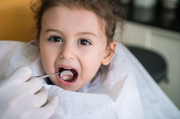 Dentist checking girls teeth
