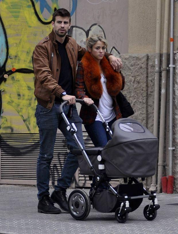 EXCLUSIVE: Singer Shakira and Spanish footballer Gerard Pique walking baby Milan in a baby stroller.  Pictured: Gerard Pique and Shakira