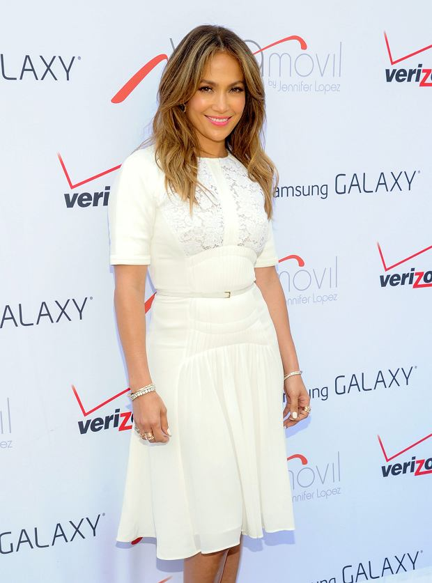 """Singer- actress Jennifer Lopez attends the """"Viva Movil by Jennifer Lopez"""" flagship store grand opening in the Brooklyn borough of New York on Friday, July 26, 2013. (Photo by Evan Agostini/Invision/AP)"""