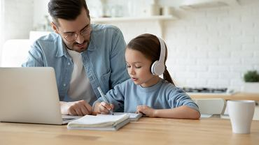 LCaring,Young,Father,Help,Little,Preschooler,Daughter,Studying,Together,Watch