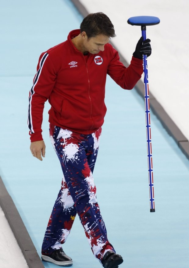 Norway's skip Thomas Ulsrud slams his broom after a missed opportunity in the ninth end during a tiebreaker game against Britain in men's curling competition at the 2014 Winter Olympics, Tuesday, Feb. 18, 2014, in Sochi, Russia. (AP Photo/Robert F. Bukaty)
