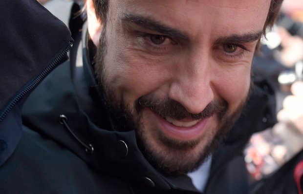 Fernando Alonso of Spain and McLaren Honda smiles during the 2015 Formula One testing at the Barcelona Catalunya racetrack in Montmelo, Spain, Friday, Feb. 20, 2015. (AP Photo/Manu Fernandez)