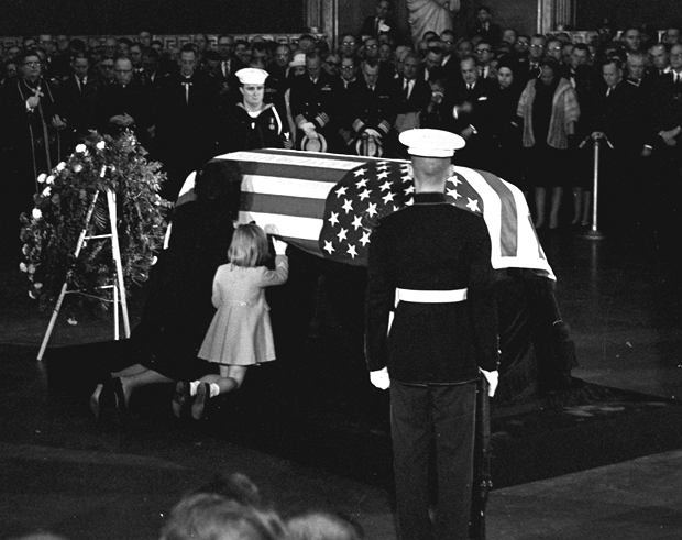 ADVANCE FOR USE SUNDAY, NOV. 17, 2013 AND THEREAFTER - FILE - In this Sunday, Nov. 24, 1963 file photo, Jacqueline Kennedy kisses the casket of her husband, President John F. Kennedy, lying in state in the rotunda of the U.S. Capitol in Washington, accompanied by their daughter Caroline, kneeling alongside. (AP Photo/Henry L. Griffin, File)
