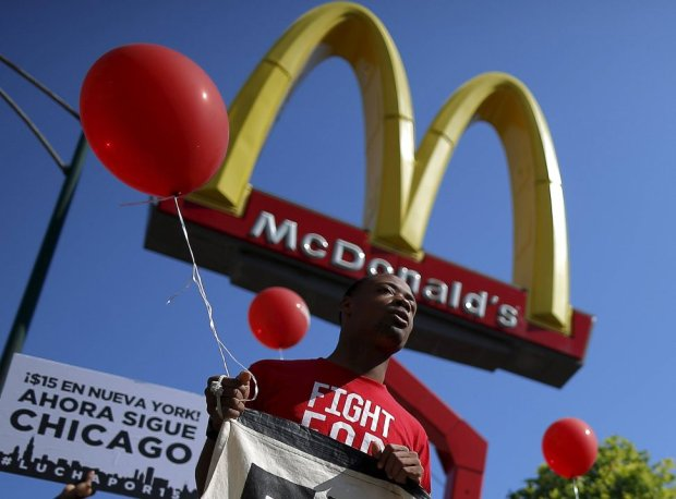 CA protestor demonstrates outside a McDonalds restaurant in Chicago
