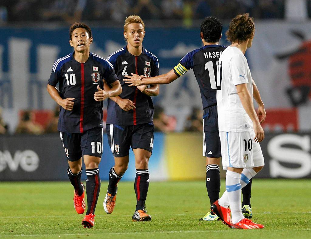 Shinji Kagawa i Keisuke Honda cieszą się z bramki