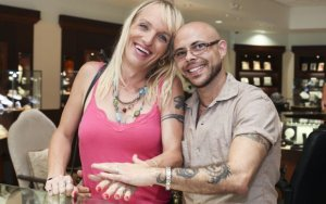 ***EXCLUSIVE*** WILTON MANORS, FL - UNDATED: Jessica Lynn Cummings, 39 poses for a picture with her fiance Mark Angelo Cummings, 49 while shopping for wedding rings in Wilton Manors, Florida. Transgender couple Mark and Jessica Lynn Cummings have found true love and are planning to marry. Mark, 49, used to be Maritza. But in 2003 he transitioned and now is legally recognized as a man. Mark works out in the gym, has a radio show about being transgender and performs his own music. Jessica, 39, was raised Shawn, but was tormented all her life by feelings she was born into the wrong body. PHOTOGRAPH BY Laurentiu Garofeanu / Barcroft USA UK Office, London. T +44 845 370 2233 W www.barcroftmedia.com USA Office, New York City. T +1 212 796 2458 W www.barcroftusa.com Indian Office, Delhi. T +91 11 4053 2429 W www.barcroftindia.com
