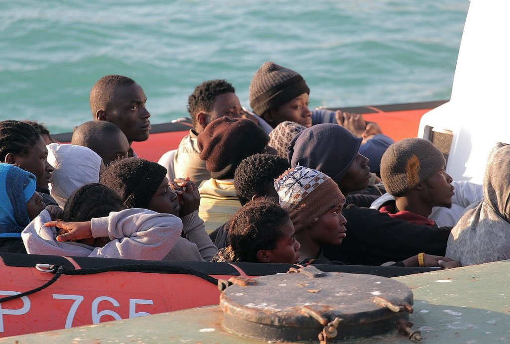 Migrants on a Coast Guard dinghy boat arrive at the Sicilian Porto Empedocle harbor, Italy, Monday, April 13, 2015. Italy's Coast Guard helped save 144 migrants Monday from a capsized boat in the waters off Libya and spotted nine bodies. It was the most dramatic of numerous rescue operations that brought thousands to safety in recent days, as good weather has encouraged the desperate to set out on smugglers' vessels. The overturned boat was spotted 80 miles north of Libya, Coast Guard Cmdr. Filippo Marini told The Associated Press in a telephone interview. (AP Photo/Calogero Montanalampo)