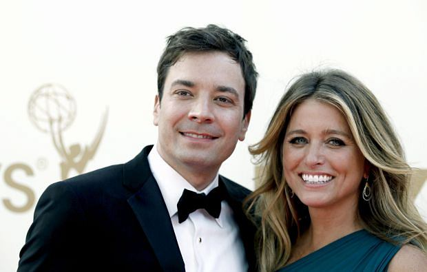 Jimmy Fallon, left, and Nancy Juvonen arrive at the 63rd Primetime Emmy Awards on Sunday, Sept. 18, 2011 in Los Angeles. (AP Photo/Matt Sayles)