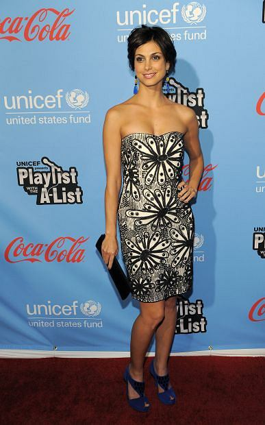 Actress Morena Baccarin poses at the second annual UNICEF Playlist with the A-List celebrity karaoke event, Thursday, March 15, 2012, in Los Angeles. The event benefitted UNICEF's Schools for Africa initiative. (AP Photo/Chris Pizzello)