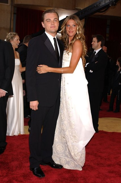 Leonardo DiCaprio and Gisele Bundchen arrive at the 77th Annual Academy Awards held at the Kodak Theatre on February 27, 2005 in Hollywood, Ca (AP Photo/Tammie Arroyo)