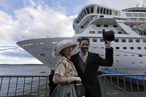Mary Beth Crocker, left, and her husband Tom Dearing from Newport Ky. pose for pictures in period costume as they disembark the MS Balmoral Titanic memorial cruise ship at its first stop in Cobh, Ireland, Monday, April 9, 2012. Nearly 100 years after the Titanic went down, the cruise with the same number of passengers aboard is setting sail to retrace the ship's voyage, including a visit to the location where it sank.With 1,309 passengers aboard, the MS Balmoral will follow the same route as the Titanic and organizers are trying to recreate the onboard experience minus the disaster from the food to a band playing music from that era. (AP Photo/Lefteris Pitarakis)