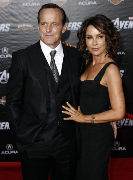 """Cast member Clark Gregg, left, and Jennifer Grey arrive at the premiere of """"The Avengers"""" in Los Angeles, Wednesday, April 11, 2012.  """"The Avengers"""" will be released in theaters May 4, 2012. (AP Photo/Matt Sayles)"""