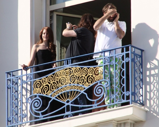 Lana Del Ray smokes a cigarette on her balcony in Cannes.  Pictured: Lana Del Ray