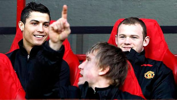 Manchester United's Cristiano Ronaldo, left, and Wayne Rooney sit on the substitutes bench either side of goalkeeper Tomasz Kuszczak before their team's  Champion's League quarter- final second leg soccer match against  AS Roma at Old Trafford Stadium, Manchester, England, Wednesday April 9, 2008. (AP Photo/Jon Super)