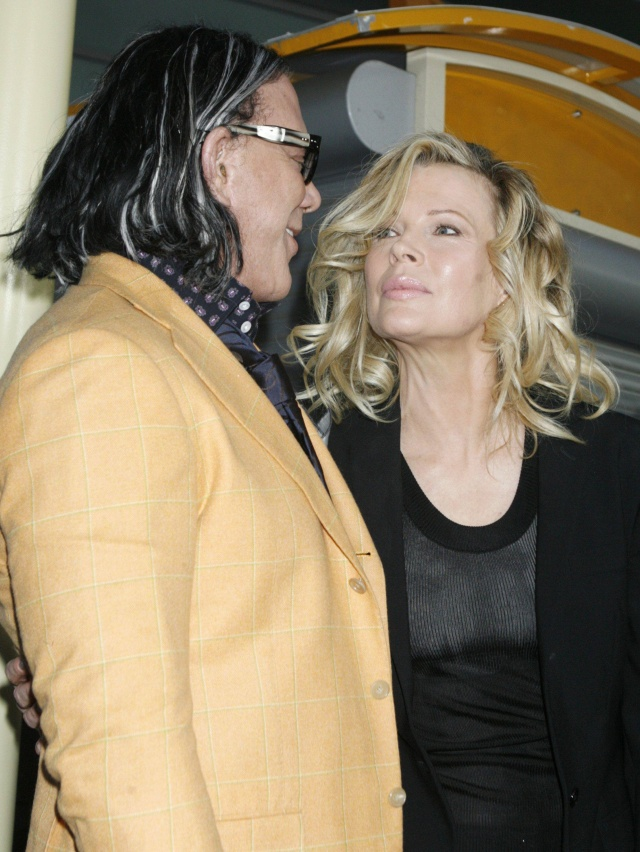 """Mickey Rourke (L) and Kim Basinger, stars of the film """"The Informers"""",  talk at the film's premiere in Hollywood, California April 16, 2009. REUTERS/Fred Prouser           (UNITED STATES ENTERTAINMENT)"""