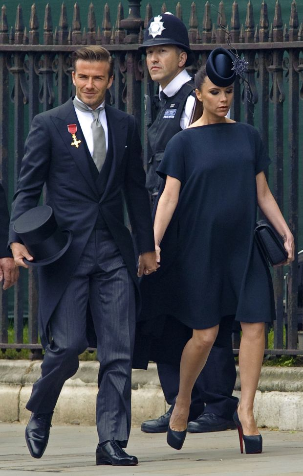 British soccer player David Beckham and his wife Victoria arrive at Westminster Abbey before the wedding of Britain's Prince William and Kate Middleton, in central London April 29, 2011.   (ROYAL WEDDING/VIP)     REUTERS/Pool     (BRITAIN - Tags: ENTERTAINMENT SOCIETY ROYALS)