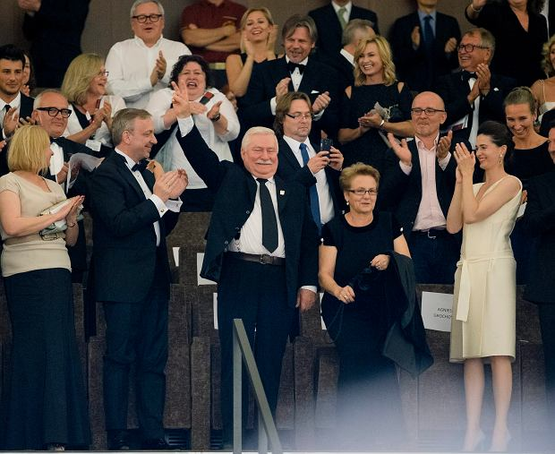 Former Polish President Lech Walesa, centre, is flanked by his wife Miroslawa Danuta Walesa, as he acknowledges the ovation before the screening of the movie 'Walesa. Man Of Hope' at the 70th edition of the Venice Film Festival held from Aug. 28 through Sept. 7, in Venice, Italy, Thursday, Sept. 5, 2013. (AP Photo/Andrew Medichini)