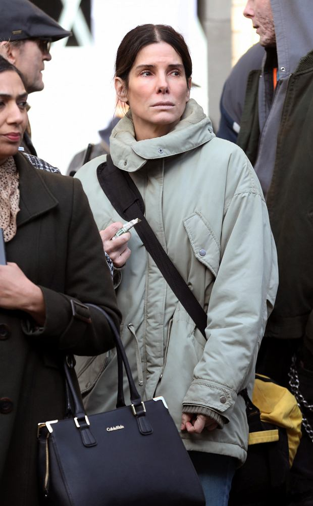 GEXCLUSIVE: Makeup free Sandra Bullock is seen on the film set of Netflixs adaptation of ITVs 2009 miniseries Unforgiven, where Sandra Plays Ruth Slater, in Vancouver, Canada. The actress was seen clutching a few dollar bills while trying to board a bus in a crowd of people - suggesting her character had just been released from prison.   The original three part series followed Slater - a woman released from prison after serving a 15-year sentence for a violent crime. Suranne Jones played the role in the 2009 original miniseries.    Pictured: Sandra Bullock      World Rights