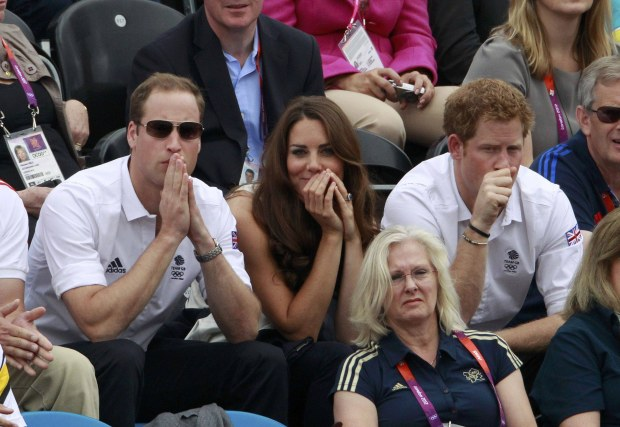 (L-R) Britain's Prince William his wife Catherine, Duchess of Cambridge and Prince Harry attend the Eventing Jumping equestrian event at the London 2012 Olympic Games in Greenwich Park, July 31, 2012.    REUTERS/Luke Macgregor (BRITAIN  - Tags: SPORT OLYMPICS EQUESTRIANISM ROYALS ENTERTAINMENT)