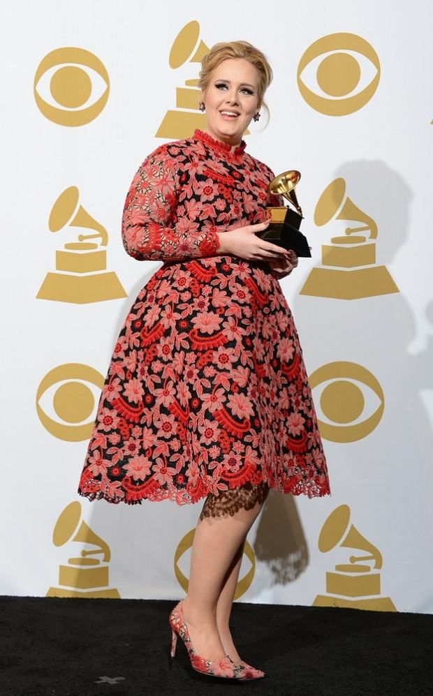 "Adele poses with her trophy for Best Pop Solo Performance for ""Set Fire To The Rain"" in the press room at the Staples Center during the 55th Grammy Awards in Los Angeles, California, February 10, 2013. AFP PHOTO Robyn BECK"