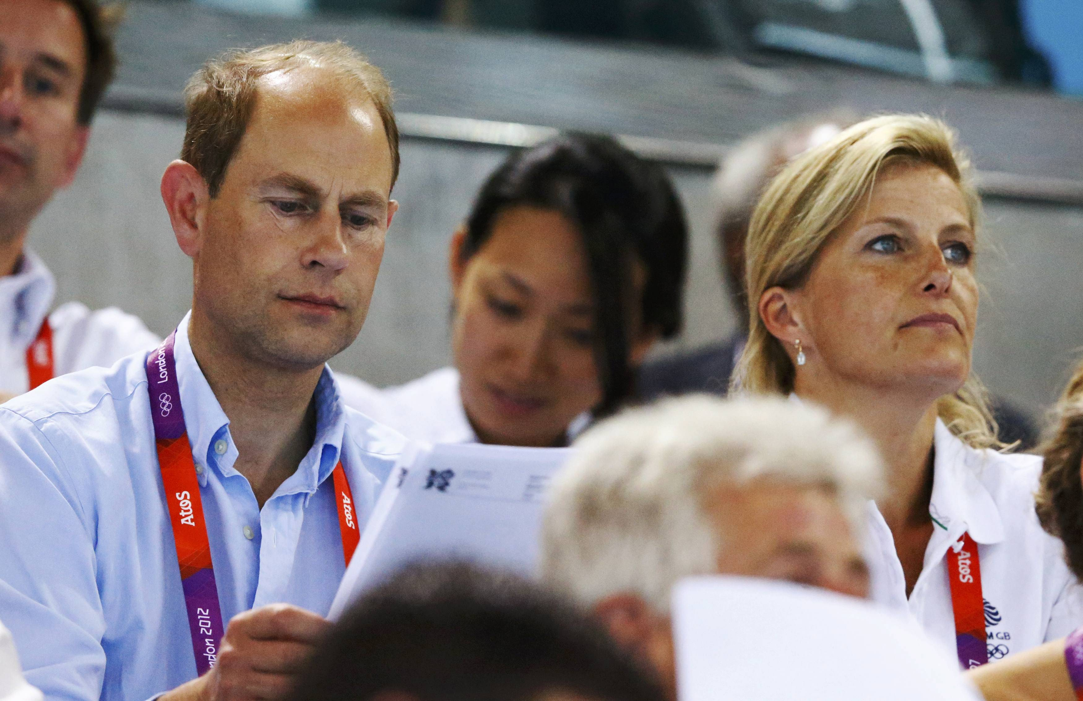 Britain's Prince Edward and his wife Sophie, Countess of Wessex, watch swimming events during day 7 of the London 2012 Olympic Games at the Aquatics Centre August 3, 2012. REUTERS/Michael Dalder (BRITAIN  - Tags: SPORT SWIMMING OLYMPICS ROYALS ENTERTAINMENT)